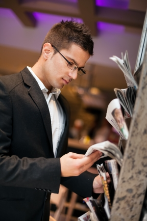 Young businessman reading  newspaper Stock Photo - 17803962