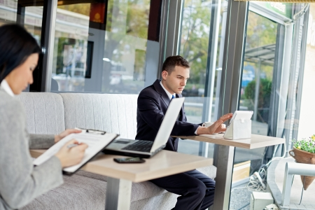 young business people in modern cafe photo