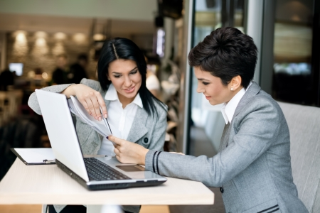 Two businesswomen nice discussing on meeting Stock Photo - 17822315