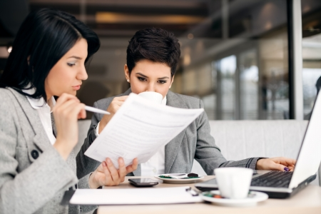 Two businesswomen consulting on meeting Stock Photo - 17821709