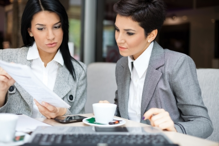 coffee shop:  Two business women in meeting Stock Photo