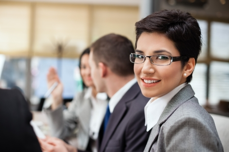 Smiling businesswoman with her colleagues in background Stock Photo - 17821931
