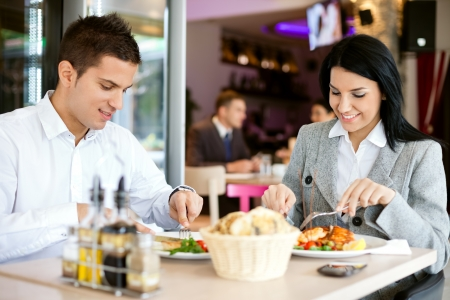 lunch meeting:  A woman and a man on a business lunch in a restaurant