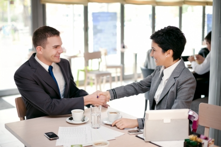 business people shake hands each other at a meeting photo