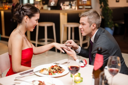 propose:  Happy young attractive couple and special proposal