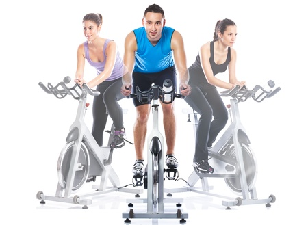 Spinning training riding on exercise bikes