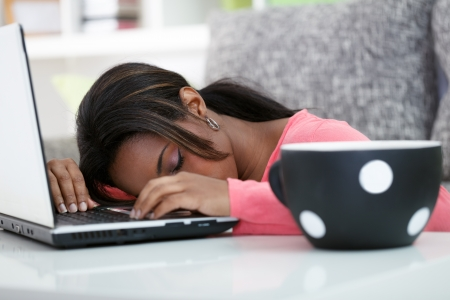 south american ethnicity:  Tired student sleeping on laptop