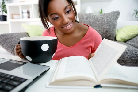 Young African student with books and laptop learning at home Stock Photo - 19404801