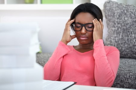 examination stress:  exhausted student woman  has a headache