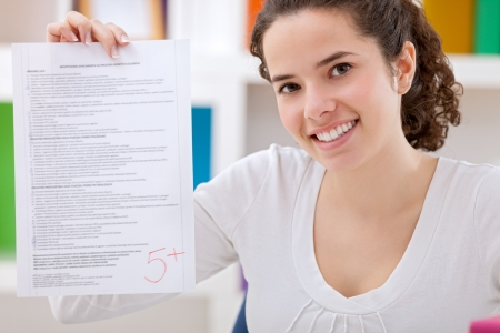 Happy schoolgirl showing her perfect  test photo