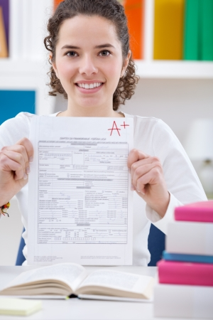 best result:  Teenager girl  holding test paper with the best result