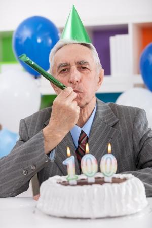 gratifying: Senior man celebrates 100th birthday Stock Photo