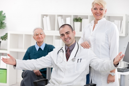 Young smiling doctor with nurse and patient at office  photo