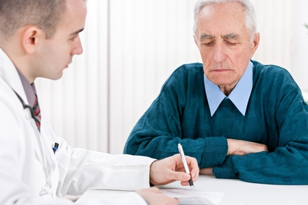 instructing:  Young doctor writing instructing of therapy for  senior patient