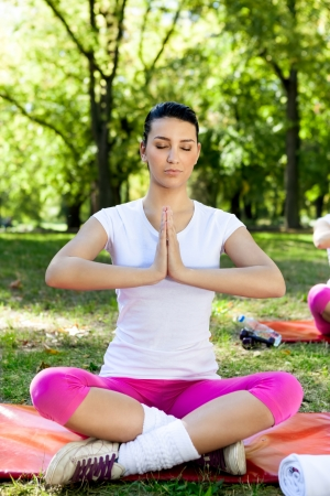 Beautiful young woman relaxing with yoga at park Stock Photo - 19404624