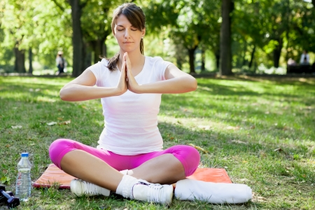 Young woman practicing yoga in park  Stock Photo - 19404505