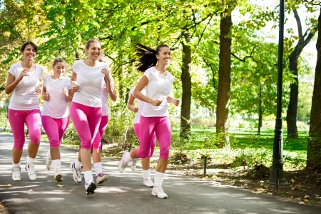 girl jogging: Runners  Jogging group in park Stock Photo