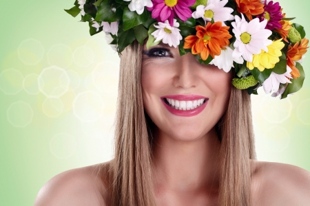 Young beautiful woman with flower wreath and great smile photo