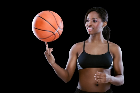 Basketball player spinning the ball on her finger photo