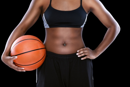 Black female  with basketball over black  photo