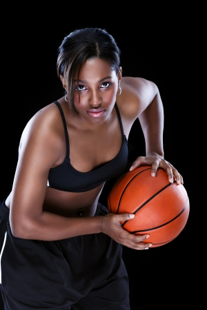 Female basketball playing basket  photo