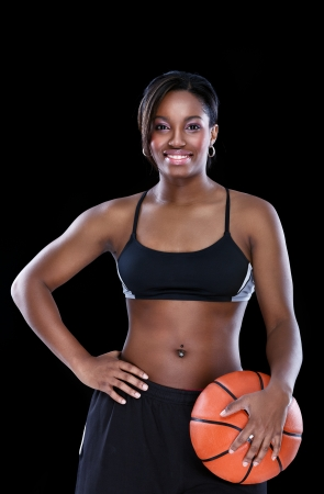 Attractive back woman with basketball over black photo