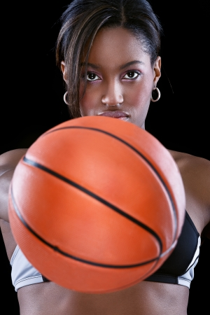 Portrait of Afro-American woman holding basketball photo