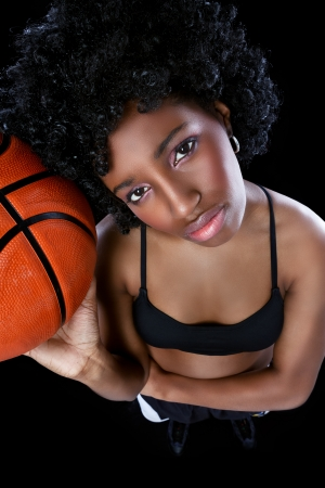 Attractive African woman basketball player photo