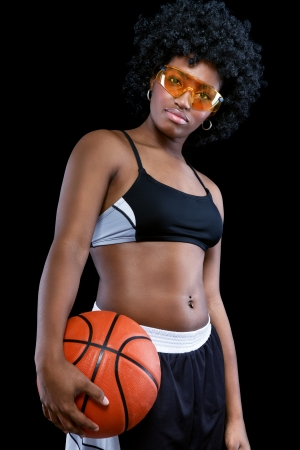 Cool African female basketball over black background  photo