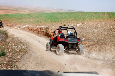 four wheel drive: Person on quadbike in the desert, beautiful view Stock Photo