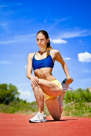 Young sporty woman Stretching Quadriceps Stock Photo