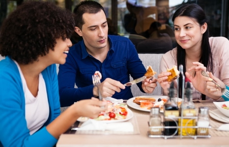 dine: teenagers friends on breakfast in cafe  Stock Photo
