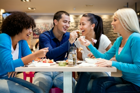 lunch break:  Happiness teenagers enjoying in lunch at restaurant Stock Photo