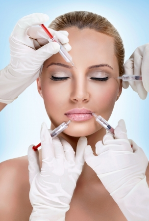 Injections of botox,  woman having beauty treatment photo