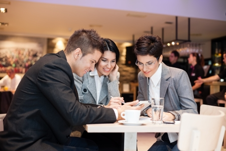 businesspeople having leisure time together in  cafe  photo