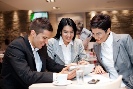 Happy business team relaxed in cafe