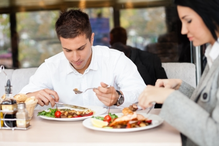 Young people or businesspeople having lunch at restaurant photo