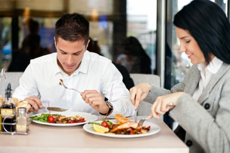 eating breakfast: Young Business couple on lunch