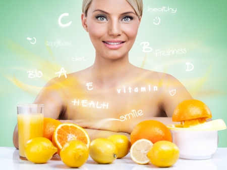 Heatlhy woman with citrus fruits and flying words photo