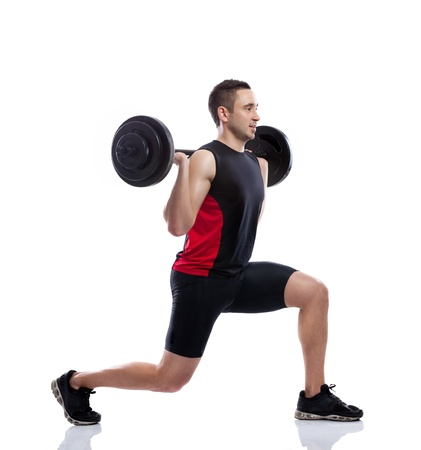 muscular body: Strong and handsome man lifting weights Stock Photo