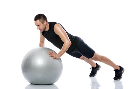Man doing fitness exercise on pilates ball photo