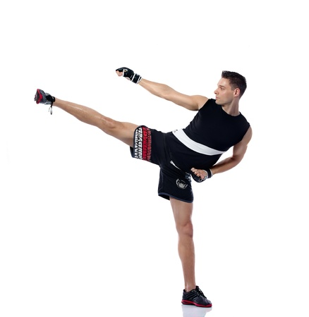 Young man kicking practicing body combat Stock Photo