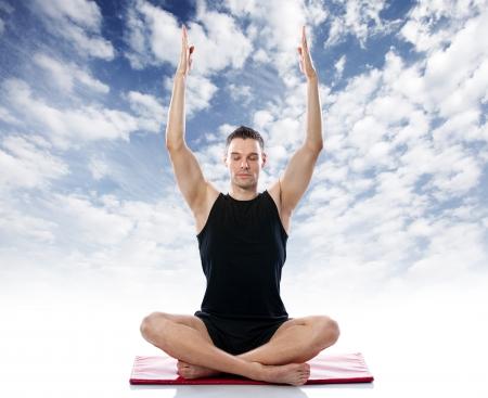 meditation man:  Serene man doing yoga  exercise against the sky, healthy lifestyle Stock Photo