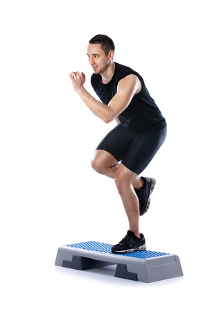 cardio: young male doing step exercise on a white background
