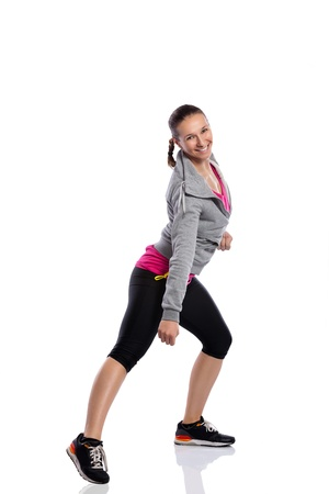 teen dance:  Young smiling woman doing fitness dance Stock Photo
