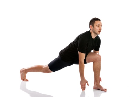 yoga man: young man doing stretching and aerobics over white