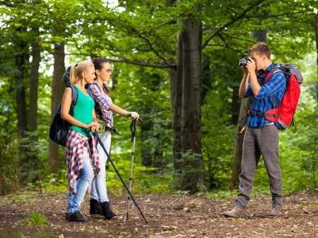 photo shooting: Young man take picture of his friends, while hiking Stock Photo