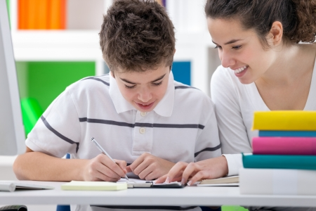education help: Sister helping brother to writing  homework