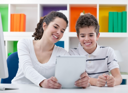 Smiling children with digital tablet at home Stock Photo - 21259554
