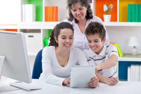 mother with her children enjoying with digital tablet  Stock Photo - 21259566